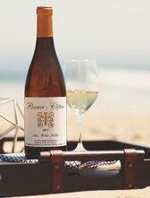 Brewer-Clifton Santa Rita Hills Chardonnay bottle on the beach