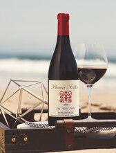 Bottle of Brewer-Clifton Santa Rita Hills Pinot Noir on the beach